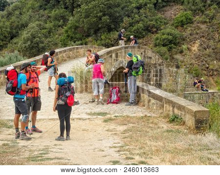 Pilgrims Have A Short Break At The Roman Bridge Over The Caudiel River - Lorca, Navarre, Spain, 6 Se