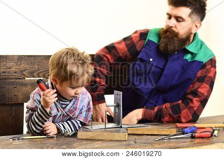 Kid With Screwdriver Playing In Craftsman. Fatherhood, Repair, Assistance Concept - Dad Teaching Lit