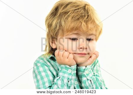 Small Boy In Green Shirt. Boy Holds Face On Hands. Close Up Portrait. Fashionable Little Child. Kis
