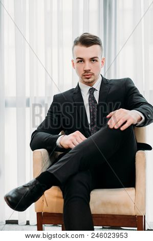 Corporate Career. Confident Successful Young Business Men Sitting In A Chair. Company Ceo Or Executi