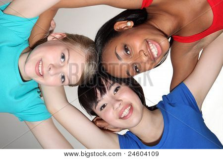 Happy Group Huddle By Mixed Race Student Girls