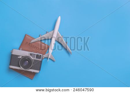 Retro Travel Objects For World Travel Concept On Blue Background