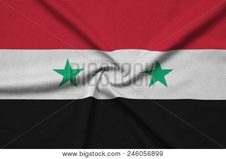 Syria Flag  Is Depicted On A Sports Cloth Fabric With Many Folds. Sport Team Waving Banner