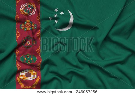 Turkmenistan Flag  Is Depicted On A Sports Cloth Fabric With Many Folds. Sport Team Waving Banner