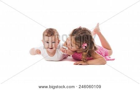 Cute Little Girl With Her Newborn Sister Or Brother, Isolated On White