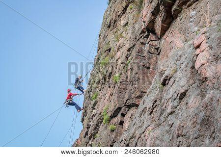 Yuzhnoukrainsk, Ukraine - June 19, 2018: Rock Climbing. A Group Of Young Rock Climbers Climb The Ver