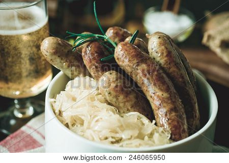 Traditional German Grilled Sausages Bratwurst With Cabbage Salad, Mustard And Beer