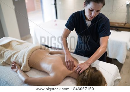 Masseur Treating Patient With Therapeutic Massage Treatment