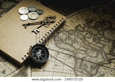 Compass, antique keys and notebook on blur vintage world map, journey concept, copy space poster