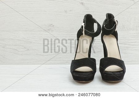 Black Suede Shoes On A Wooden Background. Fashionable Concept