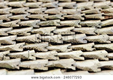 Side Of View On Old Roof With Wooden Shingles. Texture. Close-up