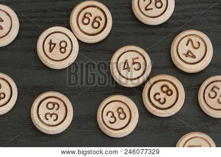 Wooden Barrels Lotto Close Up. Black Background.