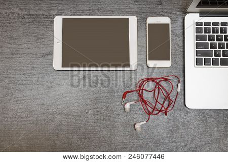 Part Of The Laptop Keyboard, Tablet, Smartphone And Headphones. Top View. Copy Space