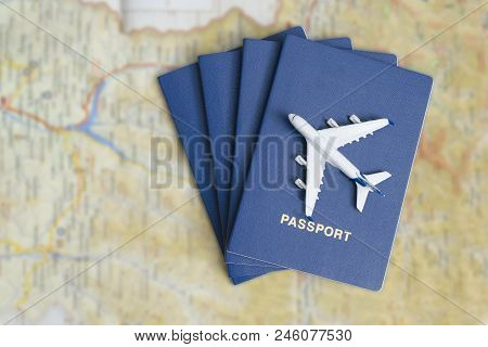 Airplane On The Blue Passports. Close Up