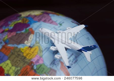 Airplane On The Globe. Travel Concept. Close Up