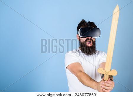 Vr Gamer Concept. Guy With Head Mounted Display And Sword Play Fighting Game In Vr. Hipster On Shout