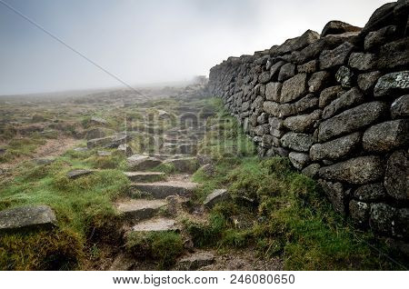 A View Up Slieve Donard Wall Towards A Low Lying Cloud.