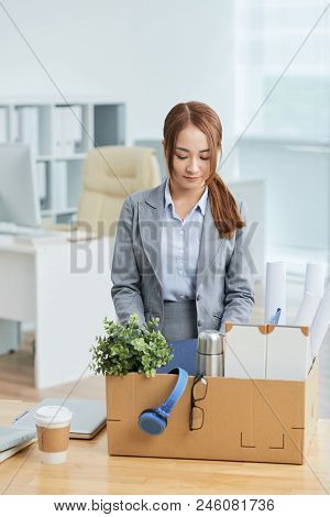 Businesswoman Unpacking Her Stuff At New Place Of Work
