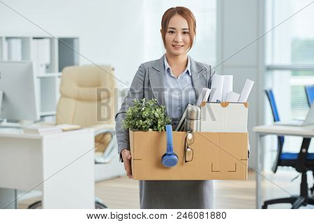 Portrait Of Young Businesswoman With Box Move To A New Office