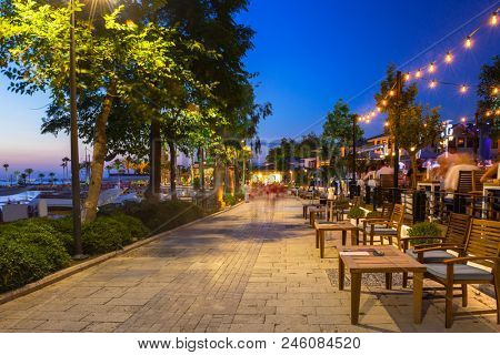 Promenade at the harbour in Side at night, Turkey