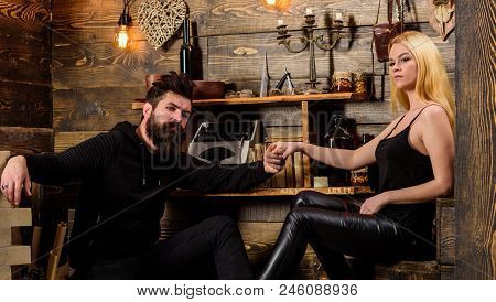 Couple Spend Romantic Evening In Gamekeepers House, Wooden Interior Background. Couple In Love Holds