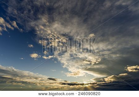 Fantastic panorama view of bright white gray dark wide puffy clouds lit by sun spreading against deep blue sky moving with wind. Beauty and power of nature, meteorology and climate changing concept. poster