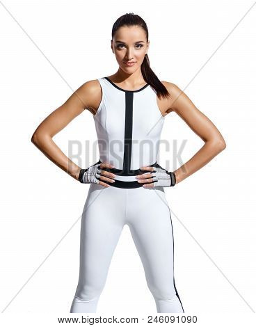 Strong Woman In Fashionable Sportswear On White Background. Ready To Workout. Strength And Motivatio