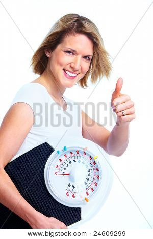 Happy young woman with scales. Weight loss. Isolated over white background.