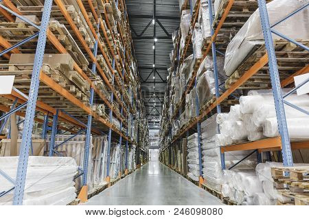 Industrial Warehouse And Logistics Concept. Large Storage With Racks, Shelves, Boxes, Containers And