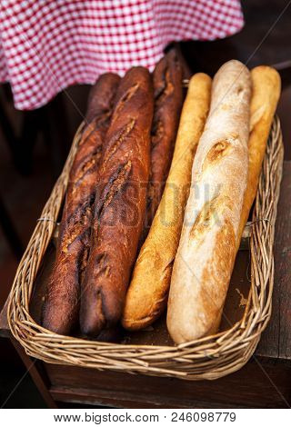 Fresh Baguettes Bread In A Basket. Many Baguettes A