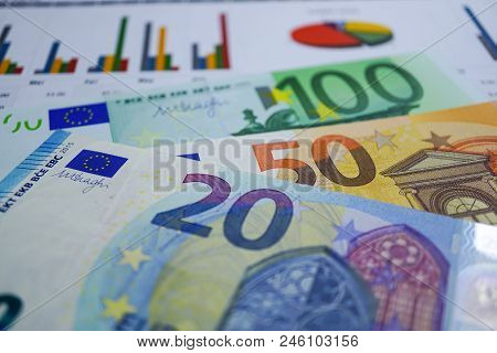 Euro Banknotes Money On Chart Graph Spreadsheet Paper. Financial Development, Banking Account, Stati