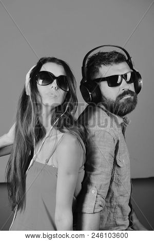 Music Fans With Serious Faces Enjoy Music, Stand Back To Back. Party And Music Concept. Man With Bea