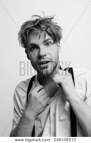 Oldfashioned style and youth concept. Guy wearing suspenders. Man with confused face isolated on white background. Student posing with bristle and fair hair. poster