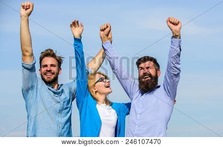 Company Three Happy Colleagues Office Workers Enjoy Freedom, Sky Background. Men With Beard In Forma