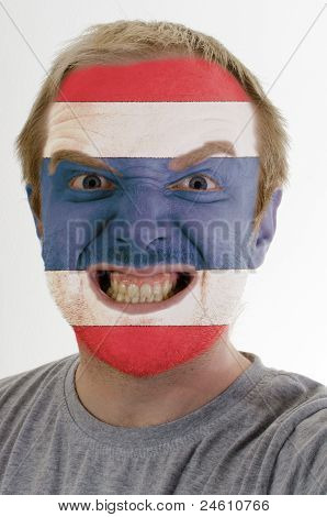 Face Of Crazy Angry Man Painted In Colors Of Thailand Flag