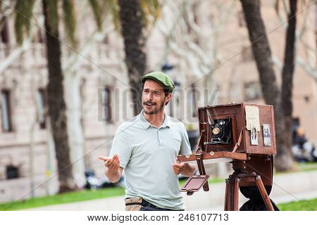 Barcelona - March, 2018: Young Male Photographer Taking Pictures Using A Vintage Wooden Camera At Th