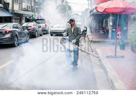 Man Fogging To Eliminate Mosquito On The Street