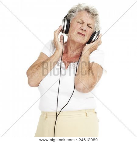 portrait of pretty senior woman listening to music with headphones over white background poster