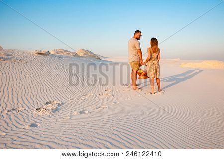 Lovely Attractive Couple On The White Sand Beach Or In The Desert Or In The Sand Dunes, Guy And A Gi