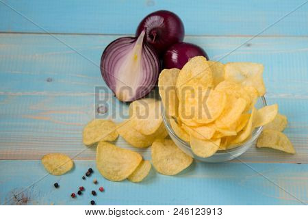 Potato Chips Homemade. Potato Chips On A Vintage Background As Detailed Close-up Shot Selective Focu