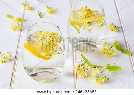 Linden Lemonade And Flowers On A White Background