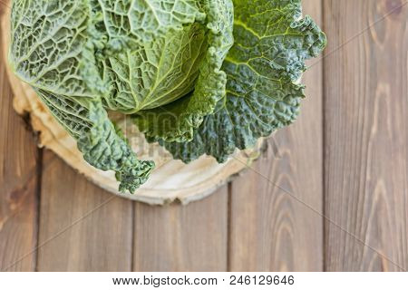 Green Fresh Cabbage On Wooden Brown Table, Savoy, Top View, Copy Space