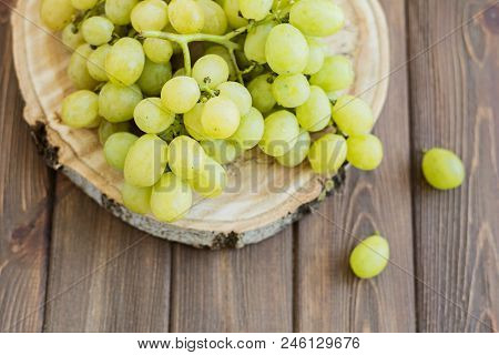 Green Fresh Grapes On Wooden Brown Table, Top View