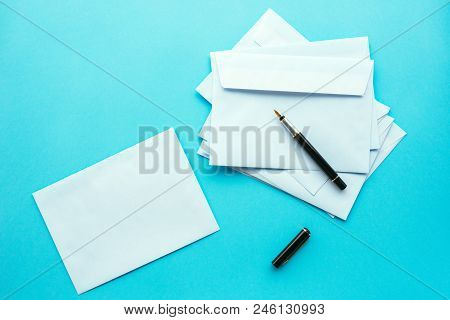 Blank white envelopes as mock up copy space for communication and correspondence themes, top view poster