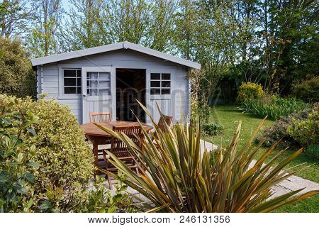 Shed With Terrace And Wooden Garden Furniture