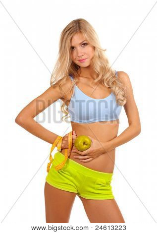 Beautiful fitness girl and measuring tape isolated on white
