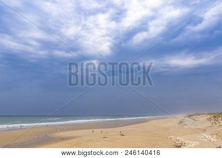 Ocean Beach On The Atlantic Coast Of France Near Lacanau-ocean, Bordeaux, France. Windy And Cloudy S