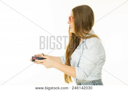 Young Adult Emotional Woman From Profile Playing On The Video Console Holding Game Pad. Gaming Gamer