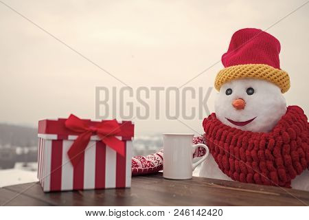 Snowman Tea Gift New Year. Happy Holiday And Celebration. Snowman In Winter Outdoor With Gift Box. N