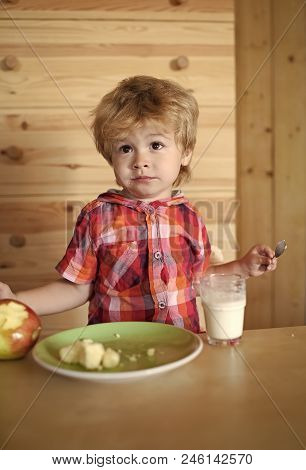 Child Eats His Breakfast. Healthy Food And Vitamin. Breakfast, Morning, Family. Small Boy Child Eat